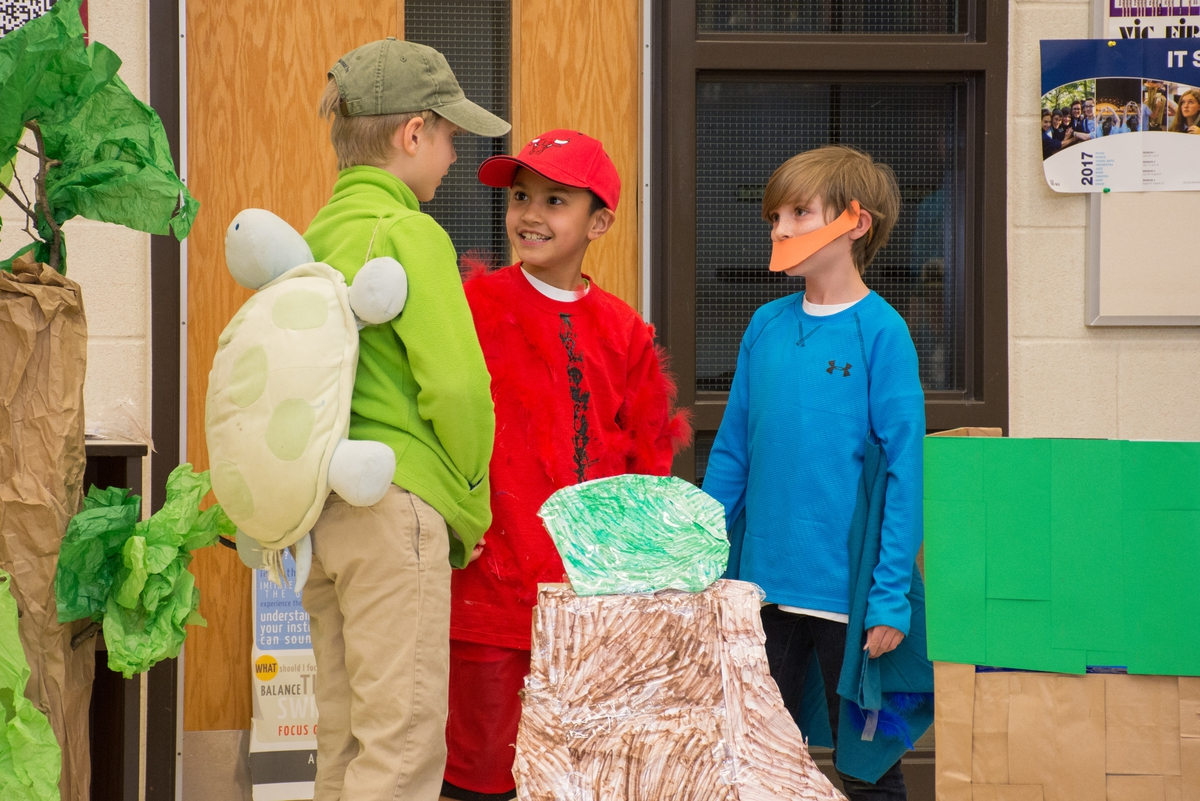 Students performing as a tournament, dressed up as a turtle and a duck.